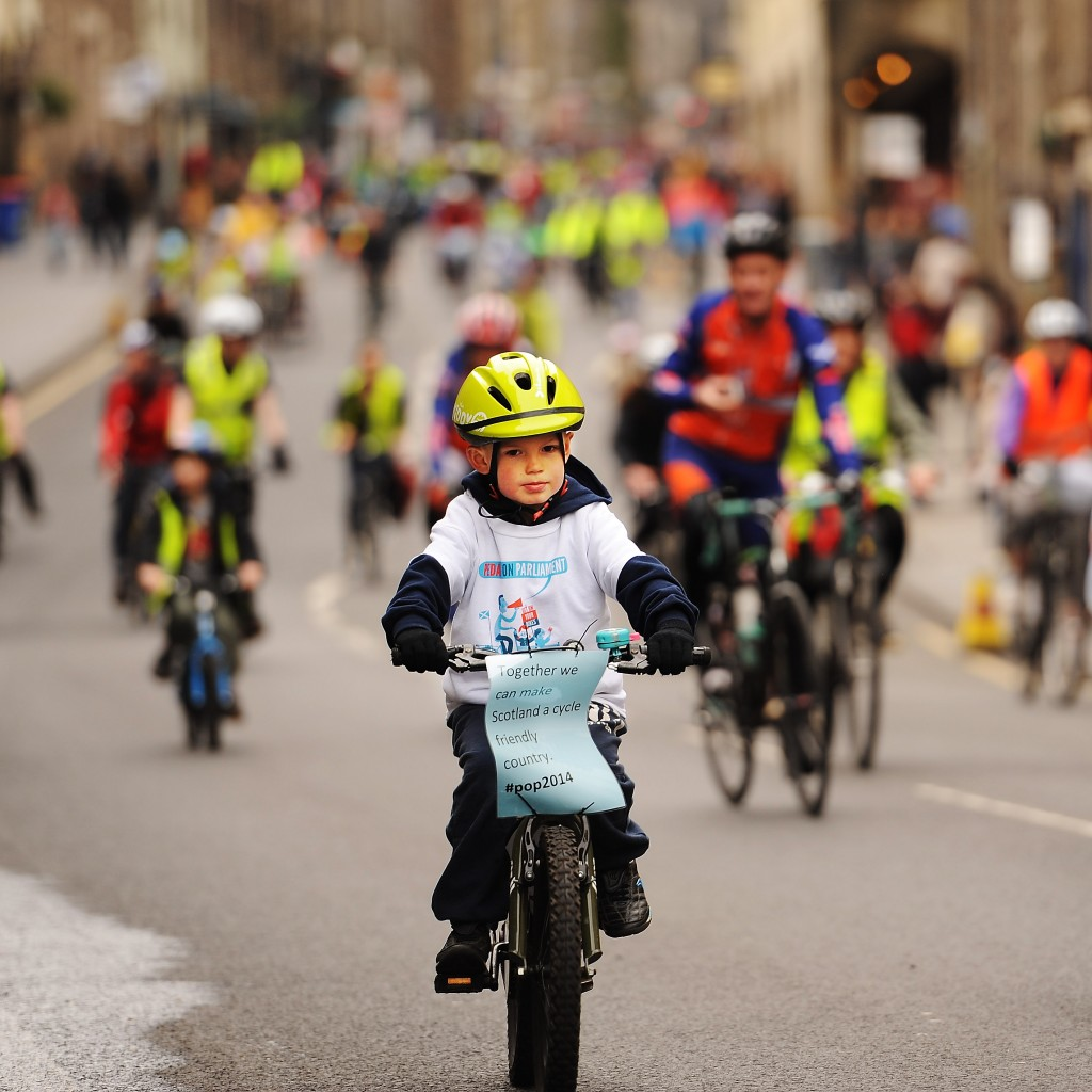 little boy pedalling on parliament