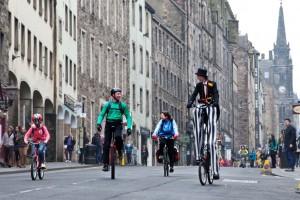 Tall bike and unicyclist