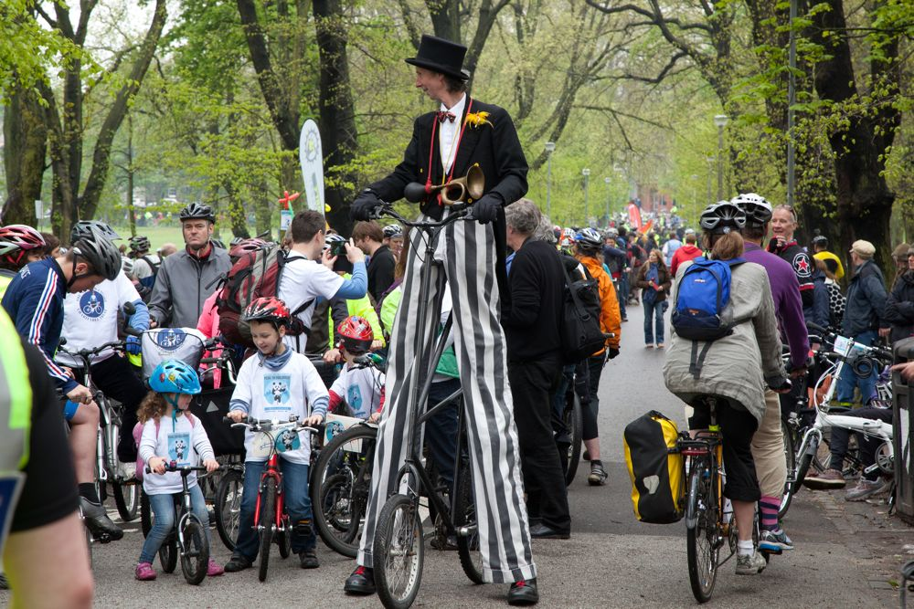 Tall cyclist alongside children