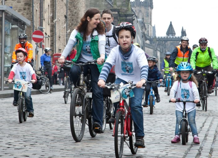 Pedalling on Parliament down the Royal Mile
