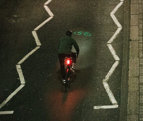 Picture of a bike projected onto a bike lane