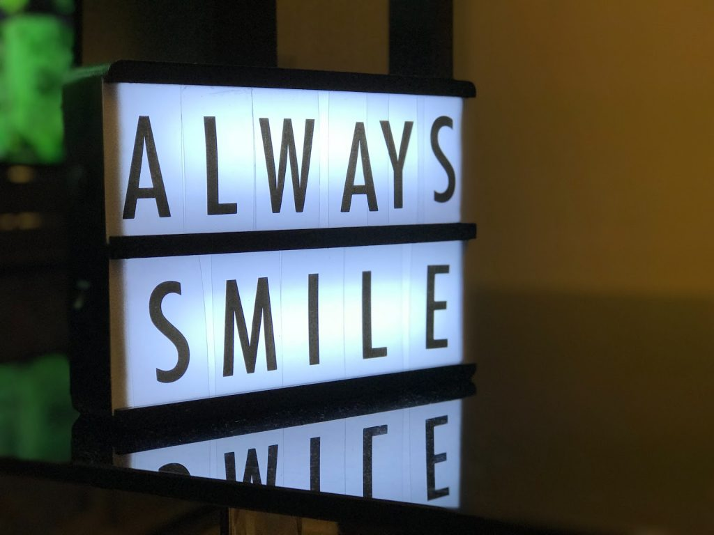 Always smile message spelled out with a light box.