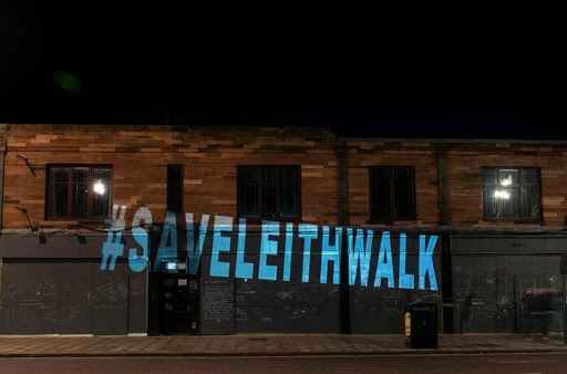 Projection of 'Save Leith Walk' on a building